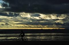 Feliz Semana... (Ruby Augusto) Tags: sunset sea beach bike silhouettes silhuetas litoralnortepaulista boracéiasp