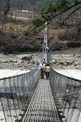 Pokhara Suspension Bridge Perspective (Heaven`s Gate (John)) Tags: travel bridge nepal people mountains river suspension steel pedestrian communication cables valley pokhara johndalkin heavensgatejohn