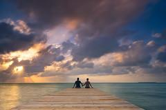 Together (departing(YYZ)) Tags: ocean travel sunset sky love landscape pier couple colorful belize holdinghands sanpedro centralamerica