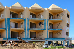 what are those blue lines? (mind_surfer) Tags: blue building architecture hope hotel coast time decay fuerteventura kanaren ruin sunny demolition ruine architektur blau sonnig canaries canaryislands gebude suites deconstruction zeit abriss kste corralejo hoffnung verfall rckbau appartements