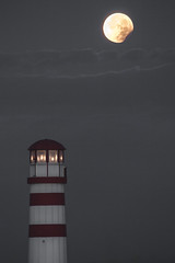 My light is waning... (stefan.el77) Tags: light moon lighthouse grey eclipse gloomy darkness full leuchtturm dreamscape mondfinsternis podersdorf shadowworld 2892015
