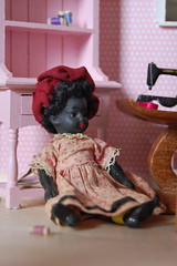 Tired Little Seamstress (Emily1957) Tags: light red wool glass toy toys miniature doll dolls lace antique sewing bisque kitlens naturallight velvet seamstress sewingmachine beret glasseyes blackdoll antiquedoll redberet nikond40 miniaturesewingroom