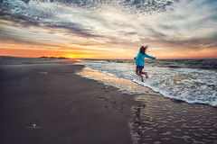 (Rebecca812) Tags: ocean travel vacation holiday seascape reflection beach nature girl beautiful childhood clouds sunrise canon freedom jump jumping sand surf waves child action happiness midair strength rearview dramaticsky carefree enjoyment vast dauphinisland rebecca812