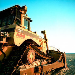 beach bulldozer xpro. santa monica, ca. 2013. (eyetwist) Tags: ocean california sky orange 6 building 120 6x6 mamiya film beach yellow analog cat mediumformat square 50mm la losangeles los xpro crossprocessed construction sand cross graphic pacific angeles kodak santamonica steel crossprocess cab cyan machine ishootfilm caterpillar machinery socal chemistry blade analogue mamiya6 process ektachrome processed e100vs berm bulldozer emulsion c41 primes f4l kodakektachromee100vs angeleno 100vs eyetwist 6mf tracl mamiya6mf ishootkodak d8t epsonv750pro filmtagger eyetwistkevinballuff crossprocessede6toc41 mamiya50mmf4l iconla