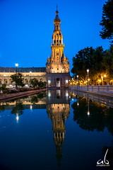 Reflection at the Plaza de Espaa (Seville) (anoopbrar) Tags: barcelona madrid longexposure travel blue sunset espaa building night clouds sunrise buildings reflections spain europe artistic angles adventure spanish hour bluehour plazadeespaa architecure goldenhour darkclouds goldenlight cloudsstormssunsetssunrises