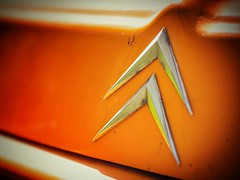 Day 3 - #orangewednesday. Close-up of the double chevron logo from an old Citron van I came across taking a walk in Haspengouw, Belgium.  #latergram #orange #vans #van #logo #citroen #citron #chevron #marque #brand #sunshine #haspengouw #hesbaye (daveoleary) Tags: from old orange 3 sunshine closeup  logo day belgium walk citroen citron an double vans van taking came across brand chevron sunnyday sunnydays haspengouw marque i orangewednesday hesbaye latergram instagood instacar like4like instacars likesforlikes
