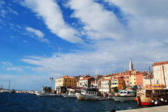 Postcard (modestmoze) Tags: blue windows red sea brown white black water yellow metal architecture clouds buildings boats concrete outside outdoors wooden waves postcard ships croatia pole deck walls pula