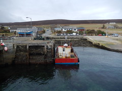 Trinian seen from its harbour (Dunnock_D) Tags: road uk sea sky cloud boats grey scotland pier boat orkney cloudy unitedkingdom harbour lamppost eynhallowsound rousay brinian b9064