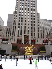 New York. The Art Deco Rockerfeller Center with its gardens and ice skating rink. Rockerfeller built 14 Art Deco buildings on this large site between 1931 and 1940. (denisbin) Tags: new people newyork man statue skating skaters rink rockerfellercenter yorkgrand centralcathedralrockerfeller centericeskatingskating rinkgold