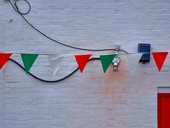 sarabande... (bruce grant) Tags: porta fios parede bandeirinhas