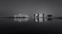 Leela Palace (kevinkishore) Tags: city longexposure light urban white black reflection beach water architecture buildings outdoors long exposure waterfront horizon estuary filter nd chennai nagar mrc urbanlife adyar