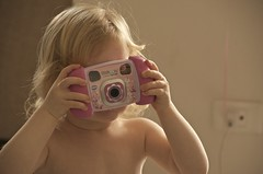 a very young photographer (Pejasar) Tags: camera toy child play ellie realcamera youngphotographer