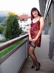 Stockings (Paula Satijn) Tags: red black sexy stockings girl hearts outside austria shiny dress legs balcony silk tgirl satin gurl nightdress chemise nightie