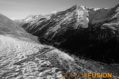 Panorama in austrian alps (Colourfusion.net) Tags: schnee bw panorama mountain snow alps austria sterreich day view outdoor tag berge trench valley alpen aussicht tal matthiasgeffert