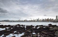 Descansa la ciudad. (Pablin79) Tags: city longexposure light sea brazil sky beach water clouds buildings coast rocks outdoor shore santacatarina balneariocamboriu