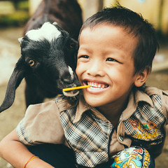 Photo of the Day (Peace Gospel) Tags: boy cute boys smile smiling animals kids children happy hope funny peace outdoor joy smiles adorable peaceful goat happiness orphan orphans goats thankful grateful empowered joyful gratitude sustainability hopeful empowerment empower
