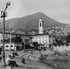 Cernobbio.1 (jean matthieu) Tags: light vacation sky people blackandwhite bw sun white lake holiday black como tree art film water vintage landscape fun photography grey lomo lomography italia artistic weekend perspective line come italie dolcevita argentique cernobbio italiana filmphotography argentic