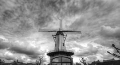 De Hostensmolen (ook Hostesmolen), ooit eigendom van de molenaarsfamilie Hoste, is een stenen windmolen in de gemeente Ruiselede, gelegen in West-Vlaanderen.t (genevieve van doren) Tags: sky bw mill clouds moulin nb ciel westvlaanderen nuages flanders ruiselede
