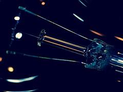 Lighting my fire... (KWinters Photography) Tags: blue light orange abstract macro glass colors lightbulb metal closeup bulb wire nikon flickr bokeh minimal rod nikkor makro nikondigital nahaufnahme cmwd cmwdblue nikondsl d3300