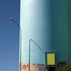 Hatch 22 (Arni J.M.) Tags: blue shadow sky brown building yellow architecture painting iceland streetlamp silo lamppost frame unfinished curve ísland akranes cylindrical hatch22 sementverksmiðjaríkisins