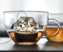 tea cup (marianna armata) Tags: food orange cup water glass leaves yellow bag gold leaf healthy tea drink bubbles fresh clear infusion pouch translucent hmm liquid herb marianna armata macromondays