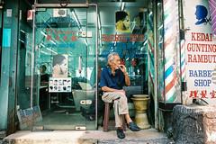 A Moment Of Serenity (Yeow8) Tags: portrait nikon streetphotography streetportrait barbershop portraiture malaysia kualalumpur chowkit agfavista400 streetphotographer nikon28ti portraiturephotography nikonfilmcamera compactfilmcamera streetportraitphotography