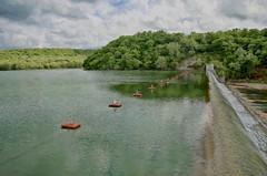 Spavinaw Dam (Pejasar) Tags: trees lake reflection art oklahoma water landscape flow paint dam saginaw spavinawlake