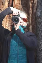 IMG_5332  The Photographer (grail76) Tags: camera woman fall sunglasses washingtondc redhead rooseveltisland
