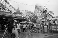 Boardwalk (bhop) Tags: california blackandwhite bw film monochrome rain nikon kodak disneyland 28mm trix disney 400tx adventure rainy f3 nikkor v700 f28e buyfilmnotmegapixels