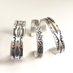 Trio of stamped cuffs.
