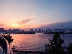 Sunset glow (Ted Tsang) Tags: park travel bridge sunset sea sky seascape japan skyline clouds reflections landscape tokyo seaside glow cityscape silhouettes olympus    odaiba minato  em1     bluehours magichours  1240mmf28