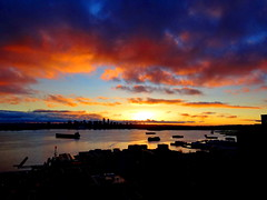 Fiery sunset explosion (+2) (peggyhr) Tags: blue sunset red orange sunlight canada black skyline vancouver bc harbour ships silhouettes thegalaxy peggyhr thegalaxyhalloffame dsc00721a
