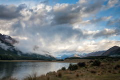Dramatic sky over South Mavora Lake in New Zealand (Dmitri Naumov) Tags: newzealand summer sky lake nature weather horizontal landscape outdoors photography evening pond quiet cloudy dusk dramatic atmosphere nobody nopeople shore lakeshore environment remote wilderness ambience climate tranquil cloudscape waterside southland scenics distant 2010 waterscape mountainrange traveldestinations colorimage moodysky beautyinnature nonurban southislandnewzealand tropicalclimate mavoralake