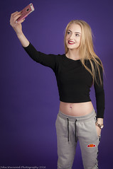 Selfie (JRT ) Tags: shadow haircut sexy apple girl beautiful smiling mobile standing pose hair studio happy evening model nikon shoot shadows boobs designer top background gorgeous tripod bra young longhair makeup cellphone trainers belly thighs stunning backdrop backlit relaxed bellybutton speedlight softbox tracksuit joggers backlighting longlegs iphone selfie strobes 2470f28 ellesse 17yearsold triggers longblondehair 840pm d300s absoluteimages jrwphotography johnwarwood flickrjrt jrwphotographycouk
