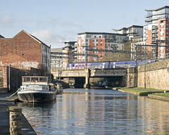 Northern over the canal (Nigel Gresley) Tags: canal leeds rail northern