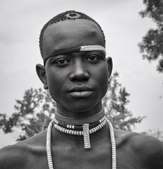 Mursi Warrior (Rod Waddington) Tags: africa portrait blackandwhite male monochrome beads outdoor african traditional tribal warrior afrika omovalley ethiopia tribe ethnic mago mursi afrique ethiopian omo etiopia ethiopie omoriver