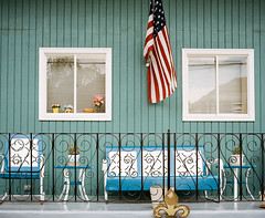 Everyday New Orleans 2015: The Porches (marysmyth(NOLA13) ) Tags: flowers windows film metal mediumformat bench chairs flag neworleans american porch 6x7 fleurdelis irishchannel kodakportra400 mamiya7ii
