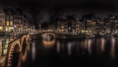 Canals of Amsterdam (mcalma68) Tags: longexposure nightphotography bridge water amsterdam architecture night bravo serene authentic monumental canalsamsterdam