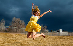 Warm light for a Love to Leap Thursday! (Flickr_Rick) Tags: woman storm girl clouds outside spring jump jumping dress legs jumpology lovetoleapthursday