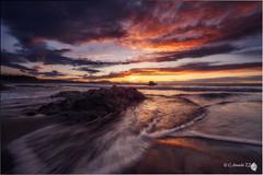 Atxabiribil (Caramad) Tags: longexposure light sunset sea espaa seascape luz marina landscape mar agua rocks wave playa olas bizkaia rocas atxabiribil marcantbrico
