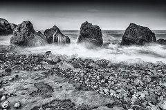 The 4 Sisters Mono (robinta) Tags: longexposure sea sky blackandwhite seascape blur texture beach water monochrome contrast outdoors mono movement rocks waves moody pentax south dramatic ks1 shields