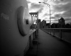 Happy Pinhole Day (The Stugots) Tags: city morning bridge sky bw white black 120 film monochrome clouds river lens photography long exposure day pittsburgh fuji slow image no pinhole shutter medium format daytime neopan 100 zero bnw zeroimage acros