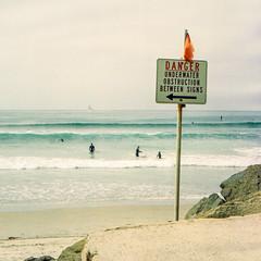 Danger (methezer) Tags: ocean california vacation color film beach sign danger analog coast sand kodak surfers coronado