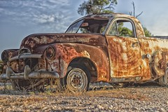Old car at Lightning Ridge, Australia (Eye of Phil) Tags: old red green classic grass car metal laughing canon mouth lens eos 50mm prime rust automobile teeth au rusty australia headlights plasticfantastic laugh queensland aussie ef sl1 lend 2016 niftyfifty 100d