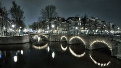 Reguliersgracht (Pat Charles) Tags: city longexposure travel bridge houses urban house holland reflection tourism water netherlands amsterdam bike bicycle architecture night reflections river canal nikon europe arch apartment terrace arches reflected 1001nights exploration 1001nightsmagiccity