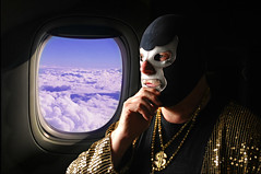 Doctor Porkchop Contemplates the Death of the Artist Formerly Known as Prince while Cruising at Altitude over Minneapolis Minnesota (Studio d'Xavier) Tags: airplane flying prince luchador luchalibre 365 purplerain purpleclouds theartistformerlyknownasprince werehere 113366 doctorporkchop drporkchop april222016 flyingpeopleorthings