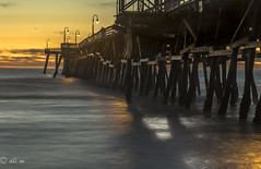 sittin on the dock of the pier watching the tide roll in (Catching_alchemic light) Tags: ocean california blue winter sunset orange sun beach clouds contrast lights wooden long exposure tide watching sanclemente sittin rollin