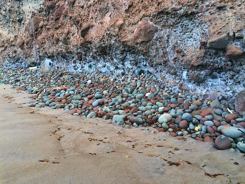Rocks that have fallen down onto the beach.