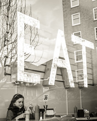 """Eat"" Sign and Window Reflection (sarahbethsmithphotography) Tags: blackandwhite restaurant fastfood streetphotography diner eat tacoma milkshake vintagestyle ttown shakeshakeshake stadiumdistrict marqueesign litupsign"