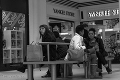 Retail therapy (Dave Vowles) Tags: street girls white black mall shopping seat